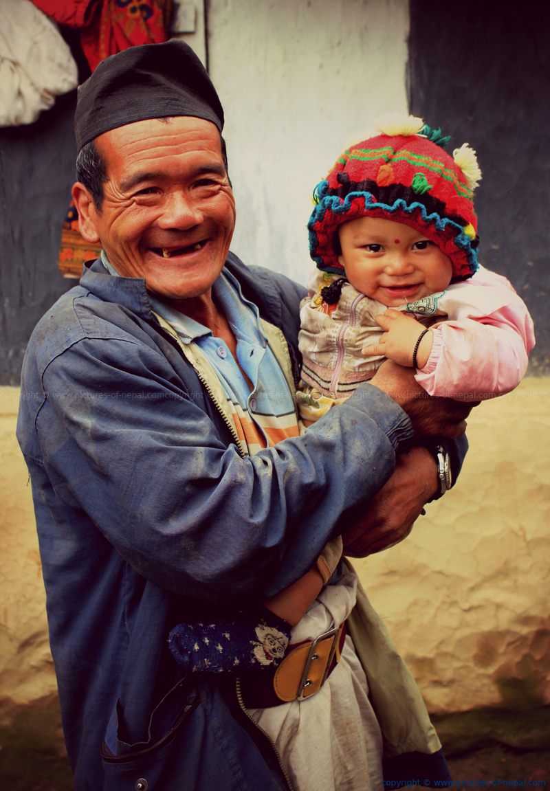 A Gurung villager with his grandson